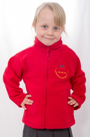 Little girl wearing a red fleece jacket