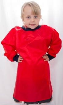 Little girl wearing a red paint smock